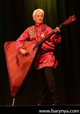 Russian dance, songs, and music ensemble Barynya, Saturday, October 13, 2018, Freeport High School, Freeport Community Concert Association, FCCA, Freeport, Long Island, New York, photo credit Yuriy Balan, contrabass-balalaika player Leonid Bruk